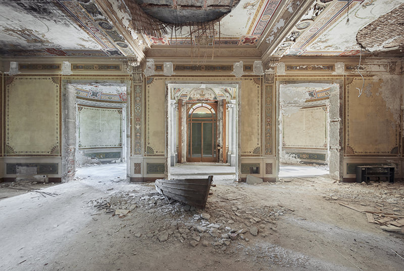 a boat inside an abandoned villa in italy
